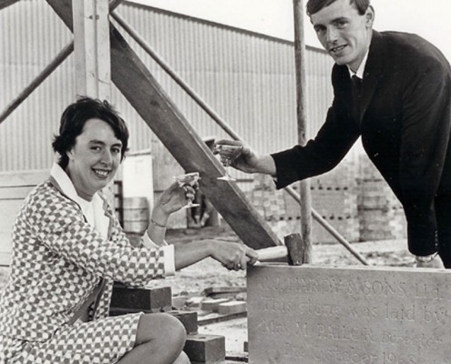 M.D. Tom Pailor helps his wife Madge lay foundation stone for our Brenda Road Factory in 1968